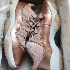 Rose Gold Air Jordan 11s low retro sneakers